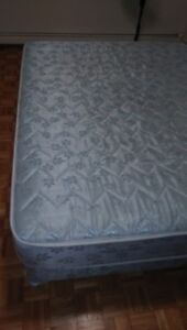 King size Mattresses with white Cover and Bed is available