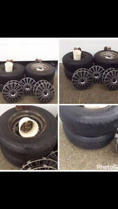 Truck tires c/w rims, hub caps, centre pieces and nuts