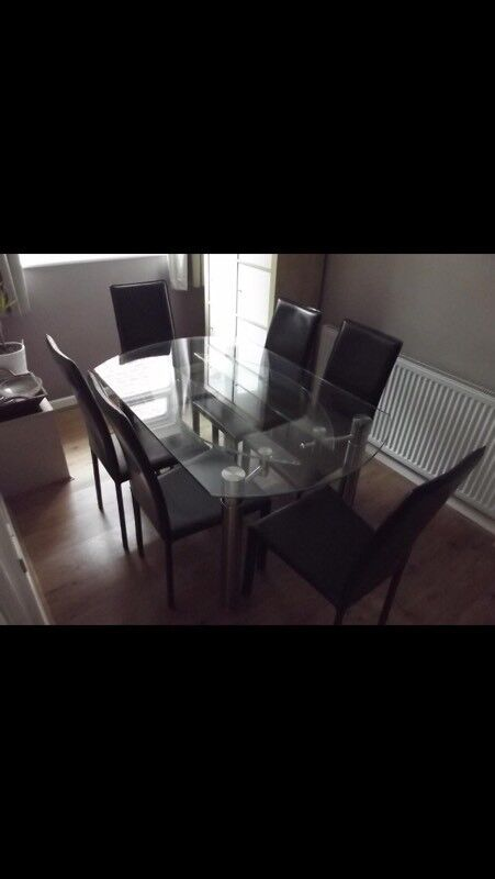Furniture Village 'Jazz' glass expandible dining table with six leather chairs