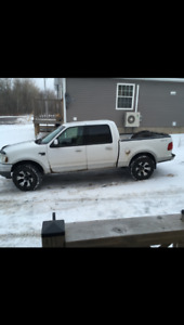 2003 f150 and 2005 Honda 350 trade for a 4 door 3/4 ton 4x4