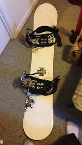 K 2 snowboard with bindings and bag