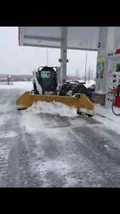 Bobcat S590 for snow plowing.  HLA 8 - 12' snow plow