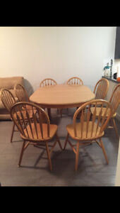 Large solid oak table set with 8 chairs for sale $300 o.b.o.