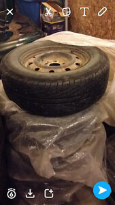 215/70 r15- 4 Michelin hydroedge tires on rims