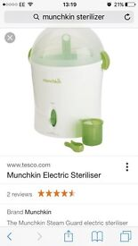 Munchkin electric sterliser like new used for couple of weeks.