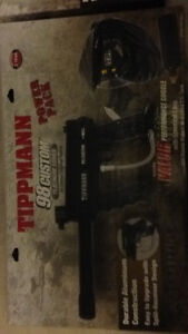 Two tipman paintball shooters