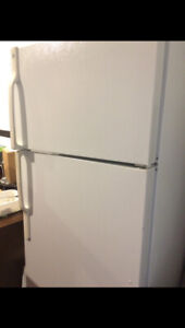 White Maytag fridge and GE stove. Excellent working condition.