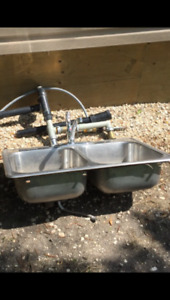 Double bowl kitchen sink, strainer baskets, faucet, drain piping