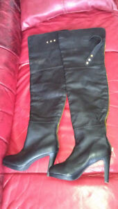 Brand New size six thigh high boots.