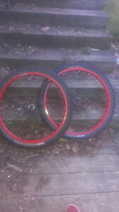 "2 26"" Kenda tires with red rims"