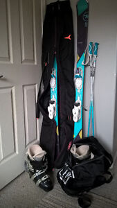 Complete ski set: skis, poles, boots and bags