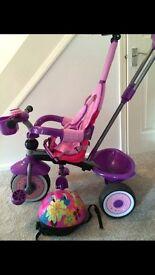 Lovely girls purple trike & helmet from Smyths - good condition