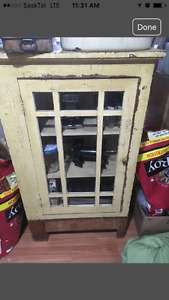 Antique cupboard with natural cracking paint