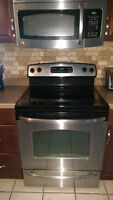 LG Stainless Steel and Black ceramic top stove and range microwa