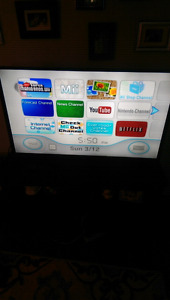 Wii with remotes and games