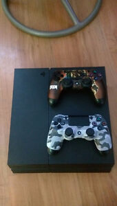 Ps4 with 2 controllers West Island Greater Montréal image 1