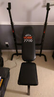 York 7700 Weight Bench, Barbell, and 120 lbs of weights