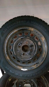 Brand New 185/65R14 86T Goodyear Ultra Grip Winter tires on rims