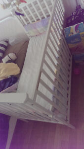 White crib with mattress, bumpers and bedding