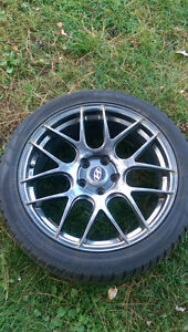 Winter tires and rims off genesis.best offer