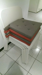 2 pink and 2 grey kitchen chair cushions