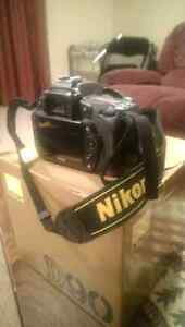 Nikon D90 + 28-80mm nikkor with boxes
