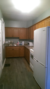 Three bedroom apartment with laundry and parking