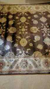 Large brown area rug 93 inches by 134  London Ontario image 2
