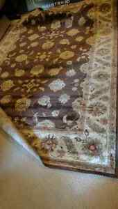 Large brown area rug 93 inches by 134  London Ontario image 1