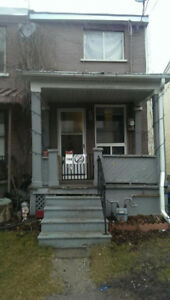 FOR LEASE: 1 Bedroom + Den Townhouse with backyard