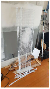 Metal shelf in white color . it is very new .