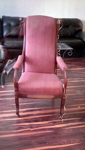 Antique reading chair original with brass wheels