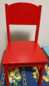 Small red wooden chair