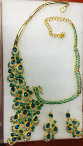Peacock shape Green gemstone, gold color bib necklace, earrings