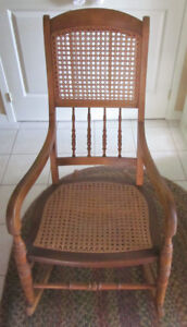 Vintage rocking chair with cane seat and back