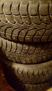 Four 215/60/17 studded tires and rims