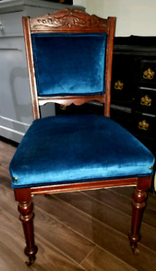 Stunning antique chair done in a beautiful teal velvet