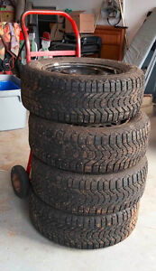 4 Studded winters tires on rims