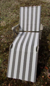 Two lawn garden chairs with cushions