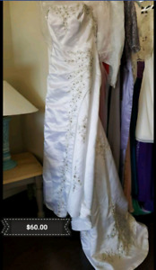 New without tags A-line satin wedding gown. In Alliston.