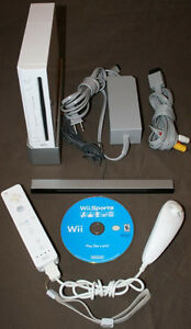 Wii with Controller, Nun-Chuck & Wii Sports