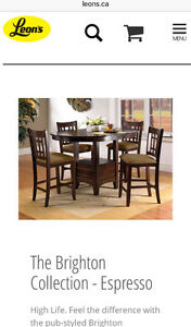 Bar style dinning room table and 4 chairs plus 4 extra chairs
