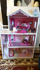 Large children's doll house with accessories