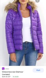 Gorgeous woman padded purple coat Faux fur hood