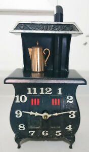 Vintage Spartus Antique Style Potbelly Stove Electric Clock