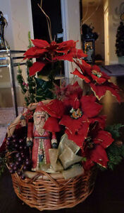 Christmas basket of poinsettias and Santa
