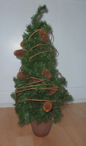 26 inch potted (Christmas) tree in clay planter