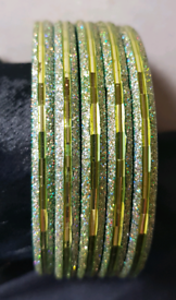 Fashion jewellery women's green coloured & glittered metal bangles