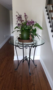 Round glass table with wrought iron base