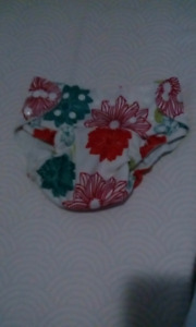 Selling 8 baby girl cloth diapers